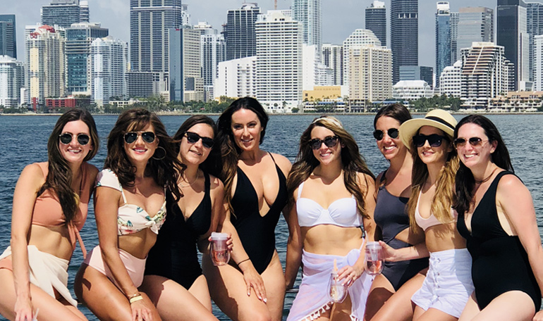 A bunch of girls take in the Miami sun while on the Black Ice yacht.