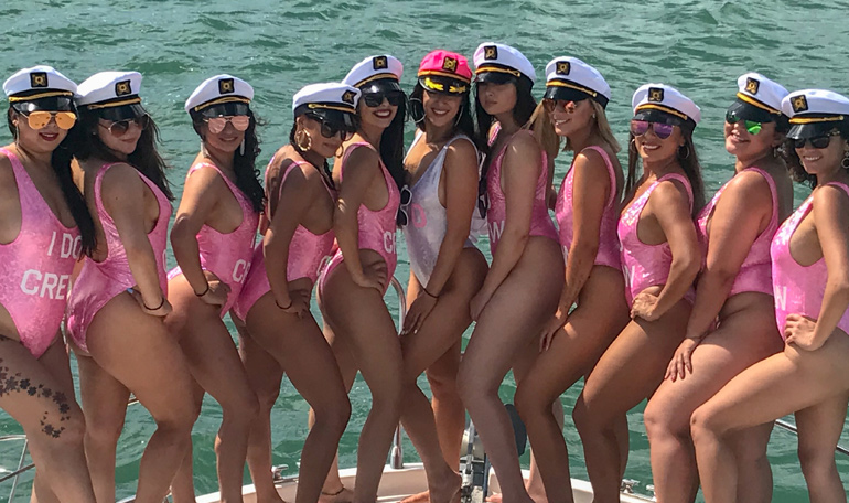 Hot Pink bathing suits help capture the fun in this bachelorette party on the Black Ice yacht.