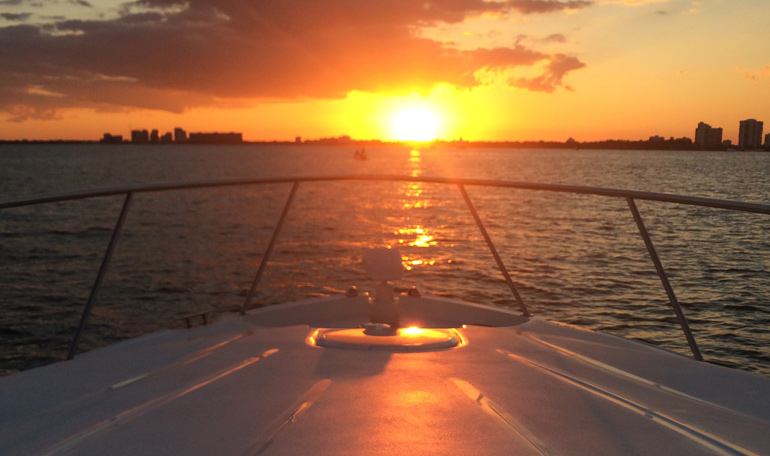Sunset in Miami seen from the bow of the Black Ice.