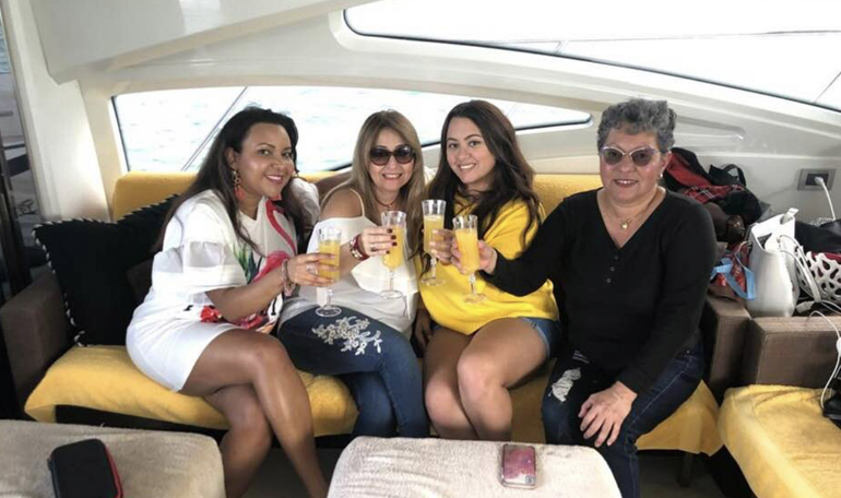 A group of ladies share a toast for Mothers Day on the Black Ice yacht.