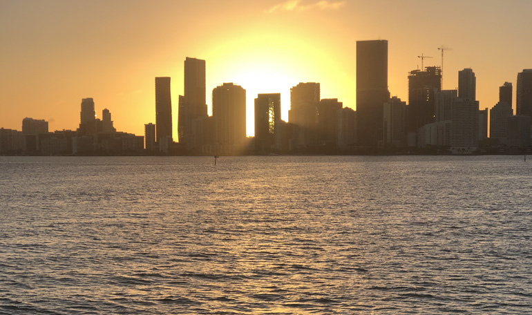 A sunset in Miami is best seen from a yacht in Biscayne Bay.